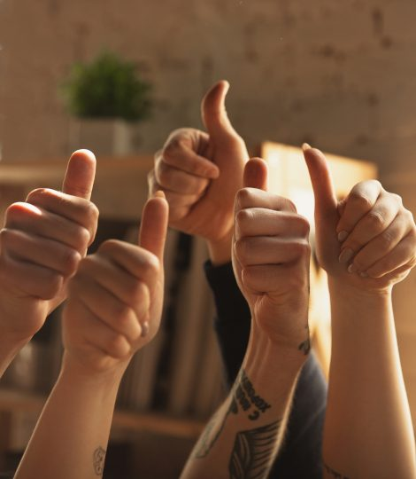 Close up of caucasian male and female hands showing nice, thumbs up. Concept of business, finance, job. Copyspace for ad. Education, communication and freelance. Teambuilding, support.